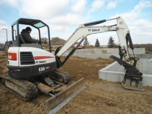 Bobcat E35 Excavator and Hydraulic Plate Packer